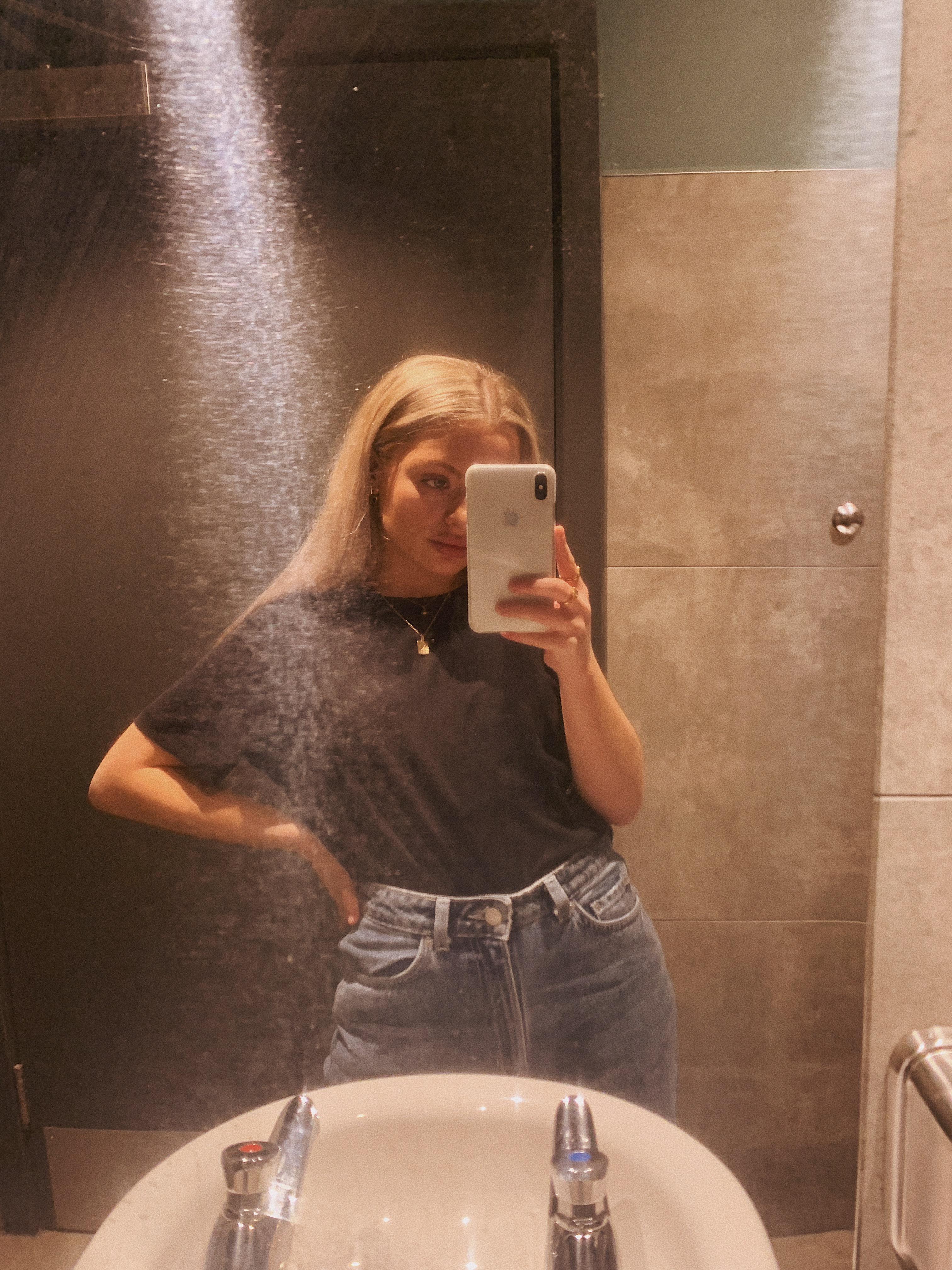Mirror selfie at Starbucks - wearing black tee and blue jeans