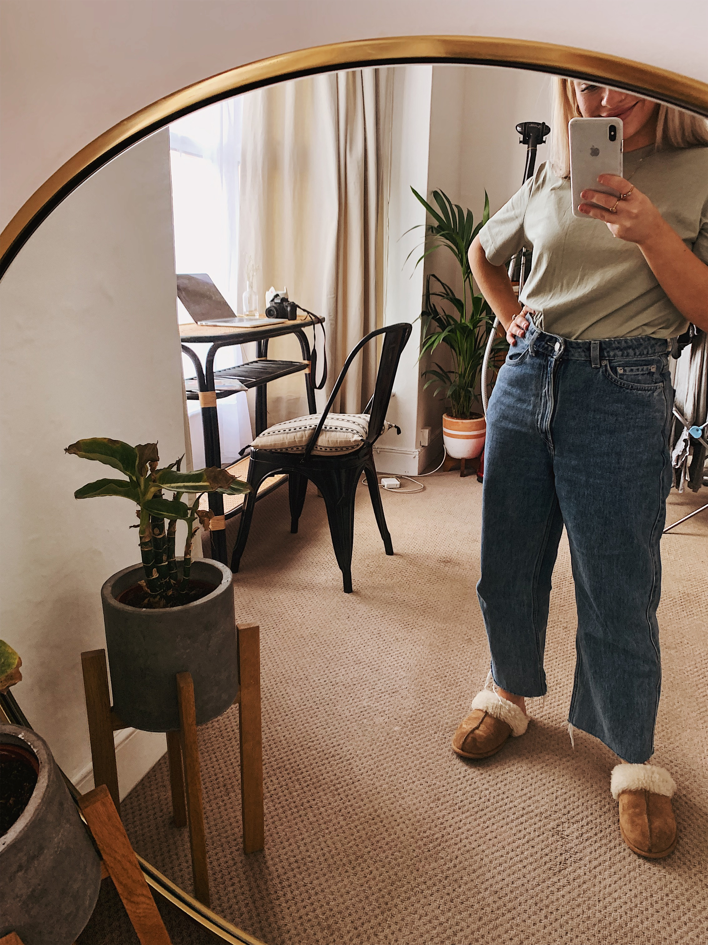 Mirror photo at home in jeans and slippers