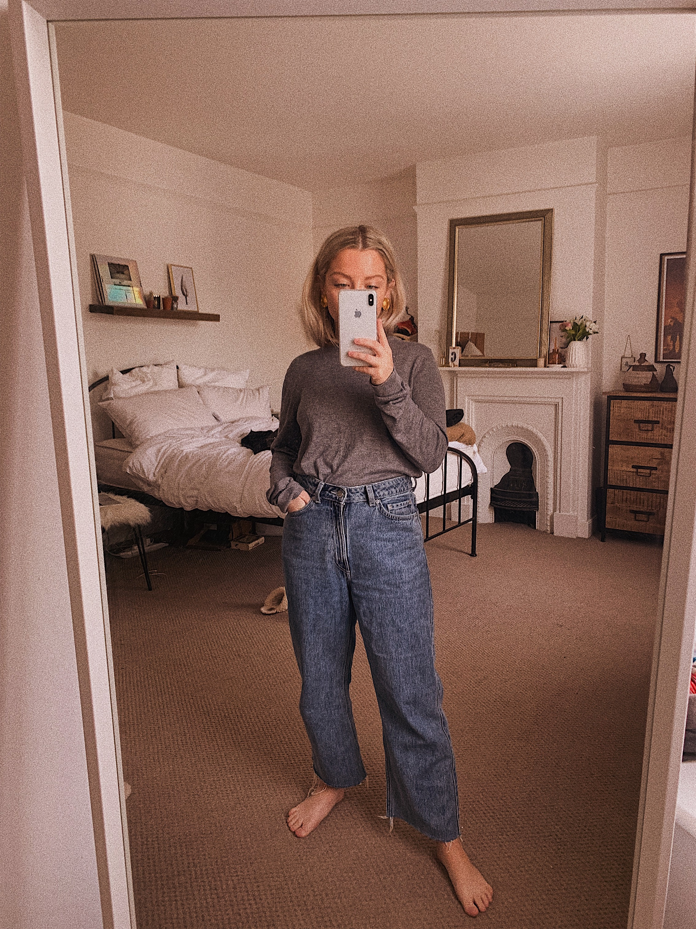 Mirror photo wearing Weekday Row jeans in Sky Blue