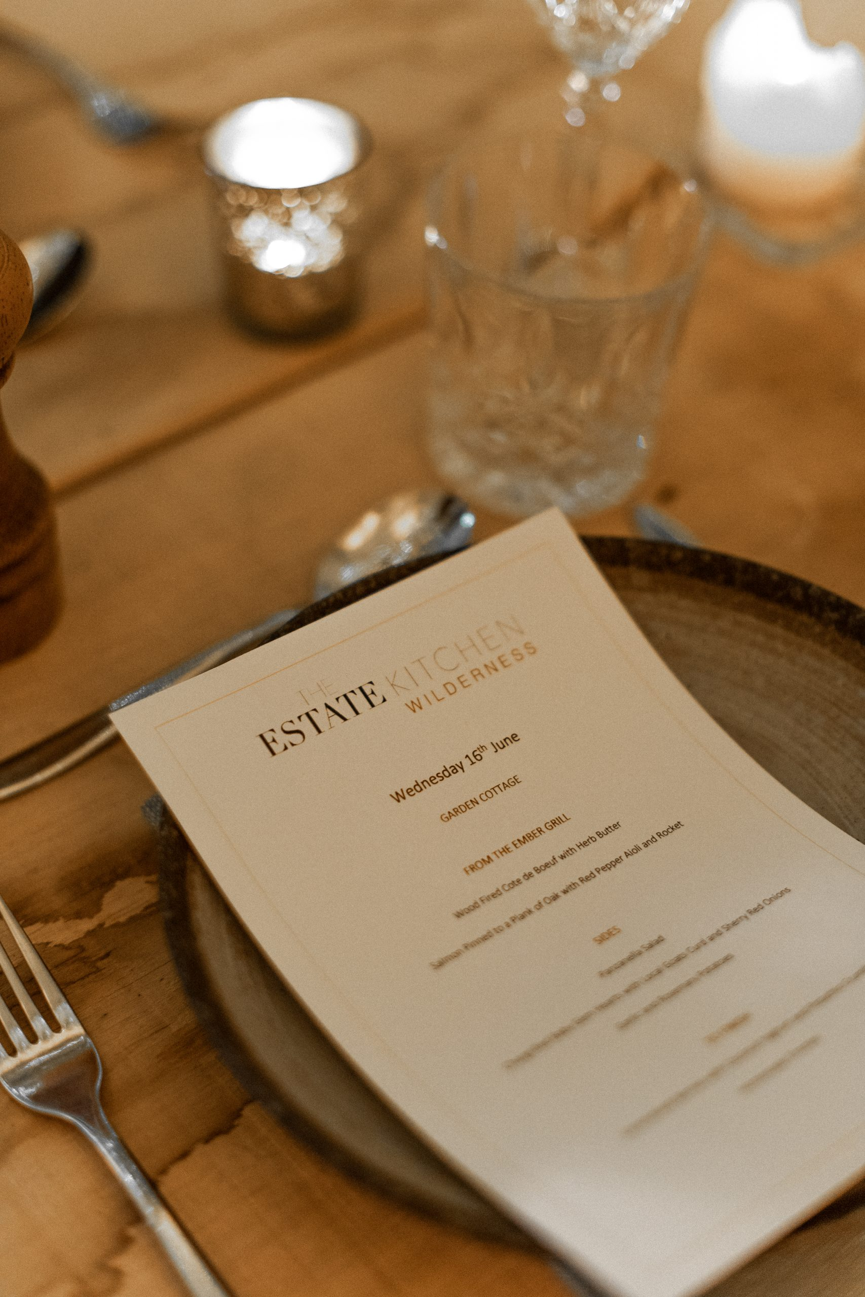 Estate Kitchen Menu - Top dishes of beef and plank-roasted salmon are visible