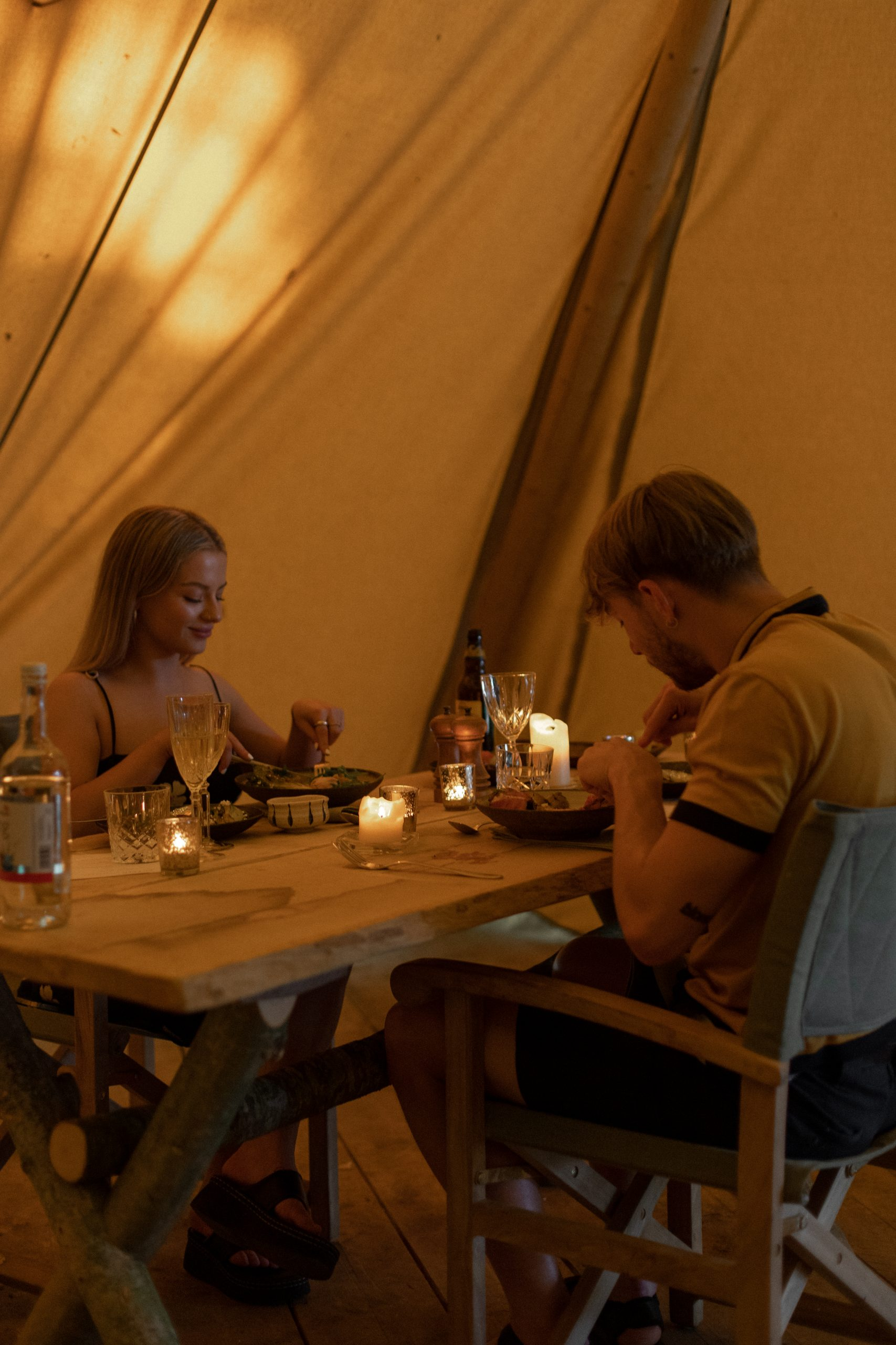 Chloe and Keiran eating dinner in the tent